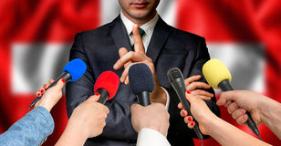 Swiss candidate speaks to reporters - journalism concept Stock Images