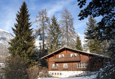 Swiss Chalet. In rural setting surounded by trees Stock Photos