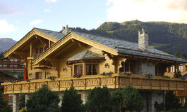 Swiss chalet. In the evening sun Crans Montana Valais Switzerland Royalty Free Stock Images