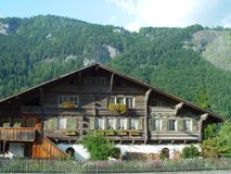 Swiss Chalet. In countryside of Switzerland Alps 500 years old royalty free stock photography