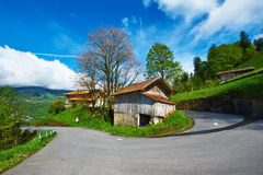 Swiss chalet at Alps Stock Images