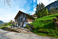 Swiss chalet at Alps Stock Photo
