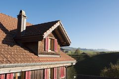 Swiss Chalet Attic Exterior: Roof and Window Royalty Free Stock Photography