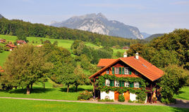 Swiss chalet. In Bernese Alps stock image