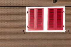 Swiss chalet with red window shutters Royalty Free Stock Photo