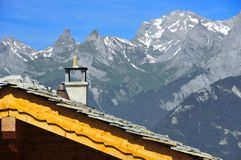 Swiss chalet roof with alps Stock Photography
