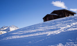 Swiss chalet in snow Royalty Free Stock Photography