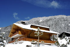 Swiss chalet in winter Royalty Free Stock Images