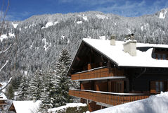 Ski lodge, Swiss chalet in winter Stock Photography