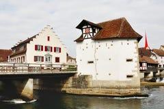 Swiss characteristic house and bridge over Reuss river in Bremgarten, Switzerland Stock Photos