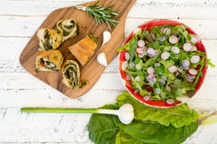 Swiss Chard Rolls on Chopping Board with Lettuce Rocket Radishes Royalty Free Stock Photo