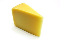 Swiss Cheese. A piece of Swiss cheese isolated on white yellow delicatessen Royalty Free Stock Images