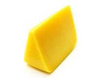 Swiss cheese. A piece of Swiss cheese isolated on white yellow delicatessen Royalty Free Stock Photos