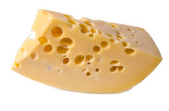 Swiss cheese. Tasty Swiss cheese with holes on a white background Stock Photos