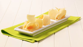 Swiss cheese and butter Stock Photos