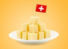 Swiss cheese cubes Stock Photos