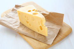 Swiss cheese on a cutting board Stock Photos