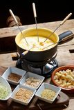 Swiss cheese fondue. Cheese fondue set on the table Stock Photography