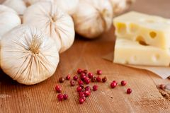 Swiss cheese and garlic Royalty Free Stock Photos