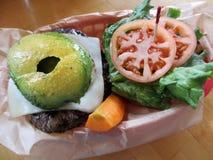 Swiss Cheese Hamburger with Veggies Royalty Free Stock Images