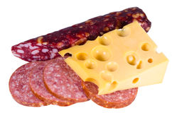 Swiss cheese with holes of a salami sausage. Swiss cheese with holes of a salami and the Moscow sausage with fat slices isolated white Royalty Free Stock Image