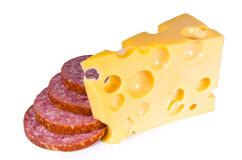 Swiss cheese with holes of a salami slices. On a white background separately Stock Photography