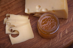 Swiss cheese with jam. On wooden desk Royalty Free Stock Photo