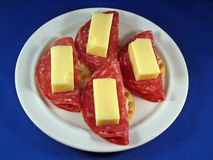 Swiss Cheese and Sopressata on Crackers Stock Image