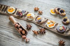 Swiss chocolate candies with nuts and dried fruits Stock Photos