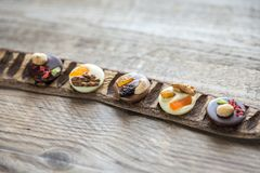 Swiss chocolate candies with nuts and dried fruits Royalty Free Stock Images