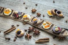 Swiss chocolate candies with nuts and dried fruits Royalty Free Stock Photography