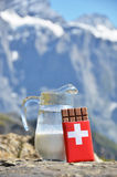 Swiss chocolate and jug of milk Royalty Free Stock Photo
