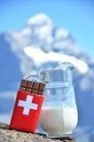 Swiss chocolate and jug of milk Royalty Free Stock Image