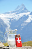Swiss chocolate and jug of milk Stock Photo