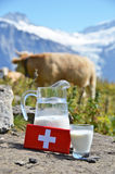 Swiss chocolate and jug of milk Royalty Free Stock Images