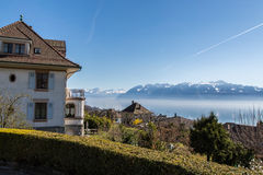 The Swiss Coast. Swiss riviera on an early spring day with the French alps in the distance Stock Image