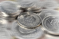 Swiss coins background Stock Photos