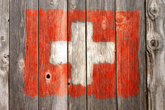 Swiss colors on old wooden wound Stock Image