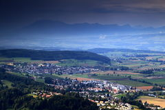 Swiss coutryside with villages, farmland, forest and mountains. Farmland, forests and villages of Bonstetten and Wettswil am Albis with Pilatus mountain in the Stock Photography