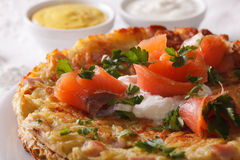 Swiss cuisine: Potato pancakes with salmon macro horizontal Stock Photo