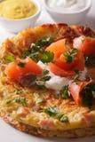 Swiss cuisine: Potato pancakes with salmon macro on a plate. ver Stock Image