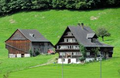 Swiss Farm. A farmhouse with a barn in the alpine region of Switzerland Royalty Free Stock Photos