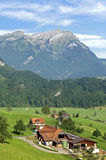 Swiss farm in Alps Mountain landscape Royalty Free Stock Photography