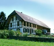 Swiss farm house. Swiss half timbered farmhouse royalty free stock photography