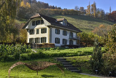 Swiss farm and house in the middle of nature near Gurten hill from  Wabern. Bern, Switzerland Royalty Free Stock Photo