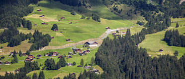 Swiss farms. A Swiss farms at mountains Stock Images