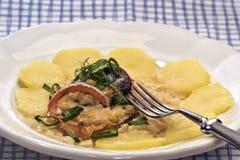 Swiss fish rolls in white wine sauce Stock Image