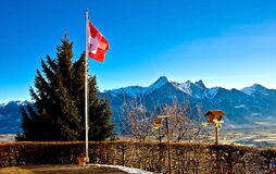 Swiss flag. Over mountains and valley Stock Photo