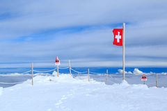 A Swiss flag above the clouds Stock Image