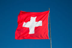 Swiss flag. Against blue sky Royalty Free Stock Images